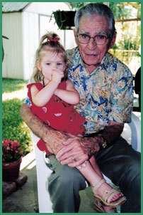 Eugene Guckian, 81, holds a great-granddaughter, Soleil